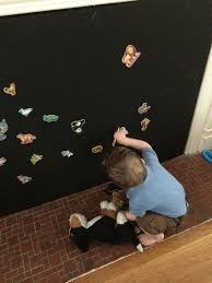 baby proofing fireplace with gigantic magnetic board