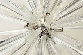 mid century modern vintage starburst style chandelier in chrome and glass for