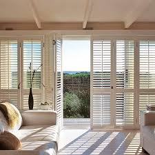 bi fold patio doors with integral blinds are perfect for warm and sunny climate interior exterior doors designs installation ideas