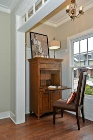 secretary desk with hutch living room traditional with abattant bead board beige walls chandelier crown living room storage hutch