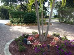 Bromeliads and Dwarf Tibouchina accent this courtyard driveway.