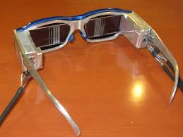 the saw toothed lens is needed to superimpose images on the actual sight normal sunglass lenses are attached to the front side of the hmd for design s