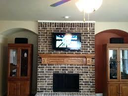 tv wall mount on brick fireplace texture
