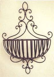 wrought iron planter hung on the