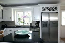 wine rack cabinet above fridge. Fridge Wine Rack Above Over The Handmade Kitchens Bespoke On Cabinet R