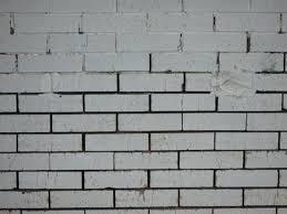 painted brick wall white paint brick wall paint garden brick wall ideas