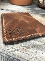 the simon leather slim card wallet is made with rustic brown crazy horse leather and saddle stitched with tan thread