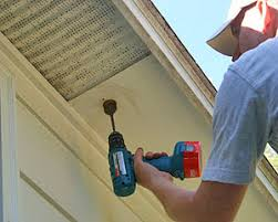 under soffit lighting. drilling large hole in wood soffit with cordless drill under lighting
