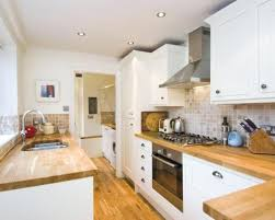 White wood kitchen Farmhouse White Wood Kitchen Cabinet Doors Photo Of With Sunken Sink Tiled And Decor Wooden Worktop Mulestablenet White Wood Kitchen Cabinet Doors Photo Of With Sunken Sink Tiled And