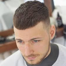 to get the french crop haircut the faded sides are naturally trimmed with a hair clipper while the cropped top is cut with scissors