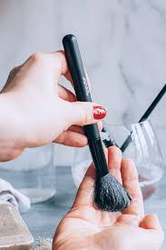 next put a little more soap and water in the palm of your hand and swirl the brush bristles around to loosen any remaining makeup