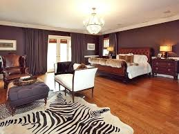 animal print rugs for living room this spacious bedroom incorporates zebra print with an area rug