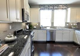 image of grey countertops and white cabinet