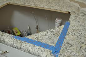 cutting a laminate countertop using a fine blade and a jigsaw we carefully cut along the