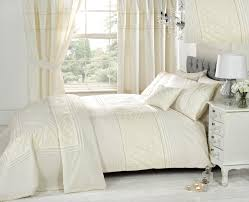 ivory bedding sets with matching curtains in white bedroom combined with white stained wooden nightstand