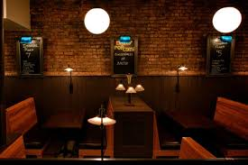 old fashioned lighting fixtures. Exposed Brick Walls, Wooden Booths, And Old-fashioned Lighting Fixtures Fill The First Old Fashioned