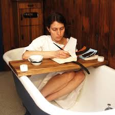 cool bathtub caddy and candle life with wooden board bathtub and a cup of tea