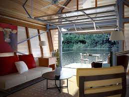 tiny house with garage. tiny house garage door residential waterfront view with e