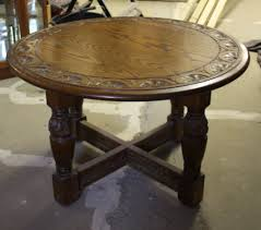 dark brown carved wood round coffee table for awesome living room decor