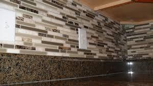 modern kitchen ideas with brown l glass mosaic tile backsplash white ceramic electric socket