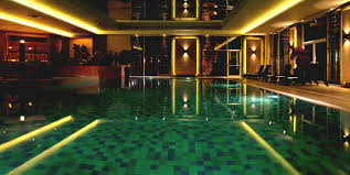 Amazing View Of Mansion With Pool At Night With Great Lighting