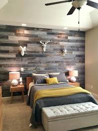wood wall accent grey reclaimed wood wall for a rustic bedroom accent wall wood decor ideas