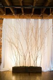 forest inspired backdrop using dry branches and twigs for your wedding wall decoration
