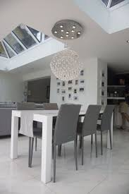 modern white dining table. bramante extending dining table, white from made.com. express delivery. make a bold, contemporary statement with this table. p. modern table e