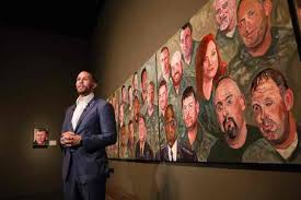 george w bush s painting book debuts at no  johnnie yellock us air force staff sergeant stands in front of a painting of