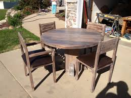 image of wood outdoor dining table round