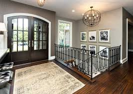 front door chandelier metal and wood chandelier entry transitional with gold frames brown wallpaper beige trim