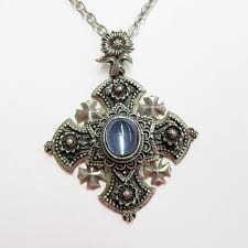ornate estate pendant with cabochon