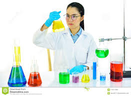 Female Lab Technician Working In Medical Laboratory Stock