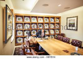 office space memorabilia. manchester oxford court pfa office boardroom football caps framed used large table memorabilia space interior s