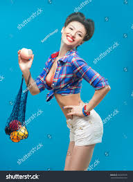 woman with pin up make up with a bag of fruit