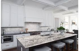 whisper white granite features a cool white background and dramatic black veins create beautiful granite countertops waterfall islands and accent walls
