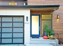 modern glass doors interior glass front doors entry contemporary with blue door wood siding wall sconce