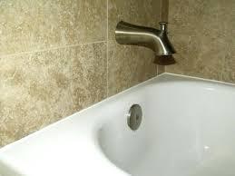 fascinating bathroom tile caulking tips very neat caulking at tub and wall connection bathroom decor ideas