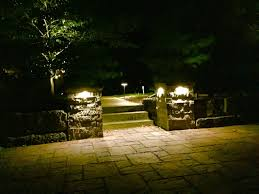 under cap pillar lighting path light and uplighting on trees