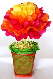 This year I created these super easy tissue paper flower centerpieces for a  mere $1.00 a piece.