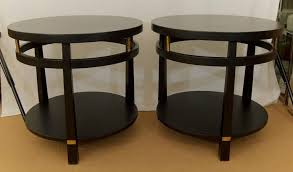 pair of multi level round satin black lacquer side tables with brass detailing