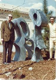 Alan Overby and Joe Cummings, Goodwill Worker of the Year, pose next to Bob  Shepherd's sculpture, 'The Goodwill Way,' commissioned …   History, The  goodwill, Empire
