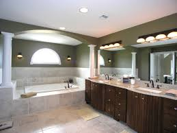 Bathroom interior decorating with green wall paint colors and light fixtures  over mirror