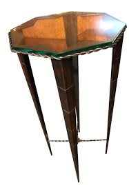 unique iron pedestal table with glass top