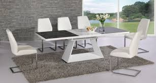 Extending black glass and white high gloss dining table ...