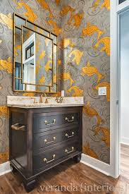 Beautiful powder room features gray and gold koi wallpaper, Osborne and  Little Derwent Wallpaper, framing gold bamboo mirror over espresso  washstand ...