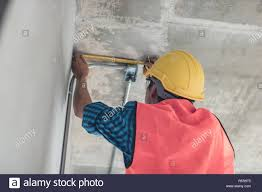 Construction Electrician Electrician Use Measuring Tape To Measure Electrical Pipe In
