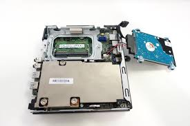 remove the hard drive to access the memory slots