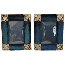 pair of turquoise velvet frames with silver filigree detail