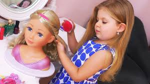 diana makes make up for baby doll